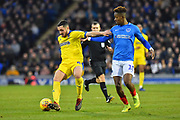 Anthony Hartigan (8) of AFC Wimbledon holds off Jamal Lowe (10) of Portsmouth during the EFL Sky Bet League 1 match between Portsmouth and AFC Wimbledon at Fratton Park, Portsmouth, England on 1 January 2019.
