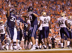 Virginia running back Cedric Peerman (37) celebrates after scoring a touchdown.  The Virginia Cavaliers faced the Pittsburgh Panthers at Scott Stadium in Charlottesville, VA on September 29, 2007.