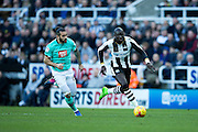 Newcastle United midfielder Mohamed Diame (#15) dribbles away from Derby County midfielder Bradley Johnson (#15) during the EFL Sky Bet Championship match between Newcastle United and Derby County at St. James's Park, Newcastle, England on 4 February 2017. Photo by Craig Doyle.