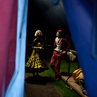 "London, UK - 25 October 2013: Natalia Goncharova (L) and Pavel Ivanov (R) in the backstage of The Moscow State Circus ""Park Gorkogo"". Natalia and Pavel are married and work together on the ""Grim Massa"" collective."