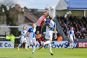 Exeter City's Jayden Stockley and Bristol Rovers Mark McChrystal challenge for an arial ball during the Sky Bet League 2 match between Bristol Rovers and Exeter City at the Memorial Stadium, Bristol, England on 23 April 2016. Photo by Shane Healey.