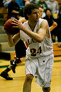 1/13/2006: Sophomore forward Ivan Platenik (24) of the UAA Seawolves grabs a rebound in the Alaska Anchorage comeback victory over Northwest Nazarene, 60-57, in men?s basketball action at the Wells Fargo Sports Complex on Saturday.
