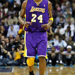 February 5, 2011; New Orleans, LA, USA; Los Angeles Lakers shooting guard Kobe Bryant (24) against the New Orleans Hornets during the third quarter at the New Orleans Arena. The Lakers defeated the Hornets 101-95.  Mandatory Credit: Derick E. Hingle