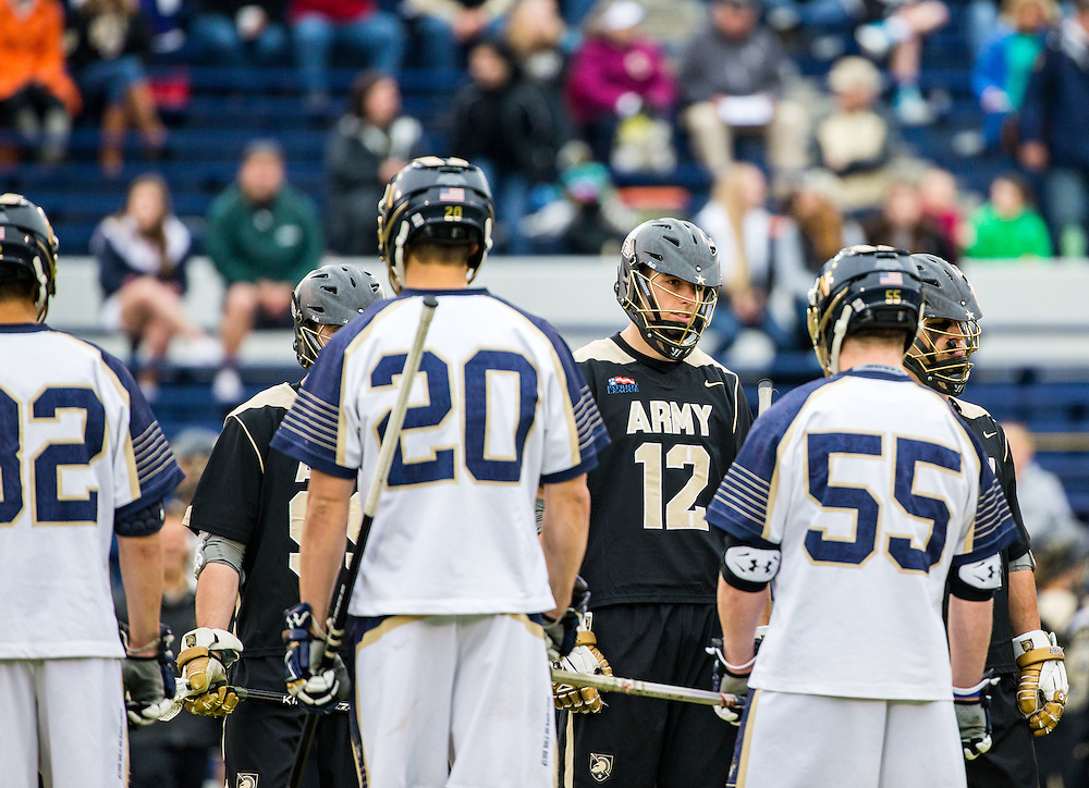 Johnny Surdick (12) of Army at the captains meeting before the start of Patriot League men's lacrosse semi-final game game between Army and Navy at Navy–Marine Corps Memorial Stadium on April 29, 2016 in Annapolis, Maryland.