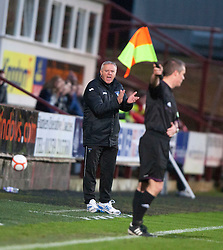 Jim Jeffries, Dunfermline's manager claps the linesman and gets sent to the stand..half time : Dunfermline v Falkirk, 26/12/2012..©Michael Schofield.