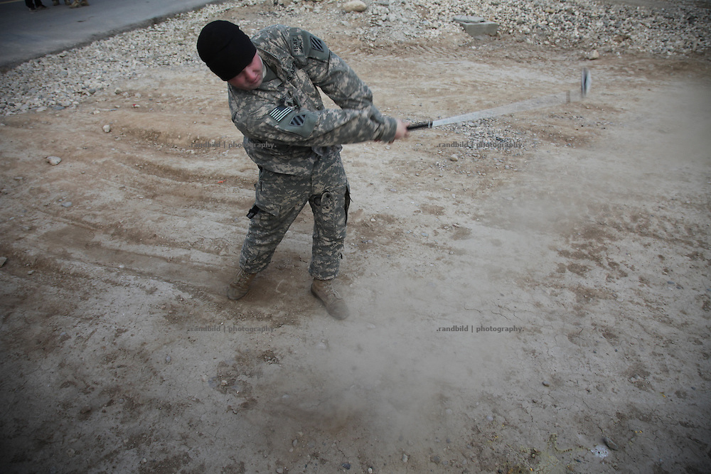 US soldier plays golf at Camp Marmal, Afghanistan
