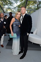 FREDDIE FLINTOFF and his wife RACHAEL at the Glamour Women of the Year Awards in association with Pandora held in Berkeley Square Gardens, London on 4th June 2013.