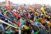 Crowds wave their vuvuzela's in unison as South Africa score the first goal. Bafana Bafana fans gather to watch the opening match of the world cup between South Africa and Mexico. FIFA fan park. Sandton. Northern Johannesburg. South Africa. June 11th 2010. Picture by Zute Lightfoot