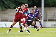 Picture by David Horn/Focus Images Ltd. 07545 970036.04/08/12.Dave Fotheringham of Chesham United and Nigel Nieta of Arsenal during a friendly match at The Meadow, Chesham.