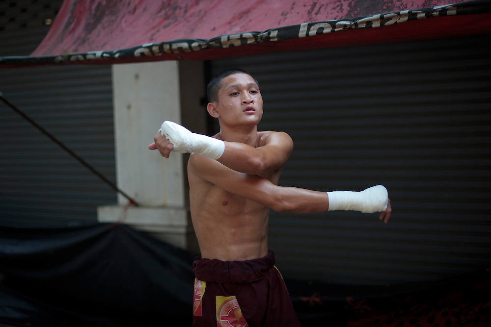 Thailand's Muay thai fighter, stretch his muscles before the traditional Songkran fight between Myanmar and Thailand beside to Myanmar-Thailand friendship bridge, Mae sot, Thailand on Friday, April. 13, 20012. Songkran festival is the Thai traditional New Year from April 13 to 15.