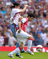 Photo: Daniel Hambury.<br />Arsenal v Aston Villa. The Barclays Premiership. 19/08/2006.<br />Arsenal's Francesc Fabregas Villa's Juan Pablo Angel battle.