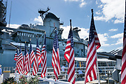 "USA flags at 1944 USS Missouri: ship served WW II, 1950 Korean War, 1991 Desert Storm. Pearl Harbor, Oahu, Hawaii. Ordered in 1940 and active in June 1944, the USS Missouri (""Mighty Mo"") was the last battleship commissioned by the United States. She is best remembered as the site of the surrender of the Empire of Japan which ended World War II on September 2, 1945 in Tokyo Bay. In the Pacific Theater of World War II, she fought in the battles of Iwo Jima and Okinawa and shelled the Japanese home islands. She fought in the Korean War from 1950 to 1953. Decommissioned in 1955 into the United States Navy reserve fleets (the ""Mothball Fleet""), she was reactivated and modernized in 1984 and provided fire support during Operation Desert Storm in January-February 1991. The ship was decommissioned in March 1992. In 1998, she was donated to the USS Missouri Memorial Association and became a museum at Pearl Harbor."