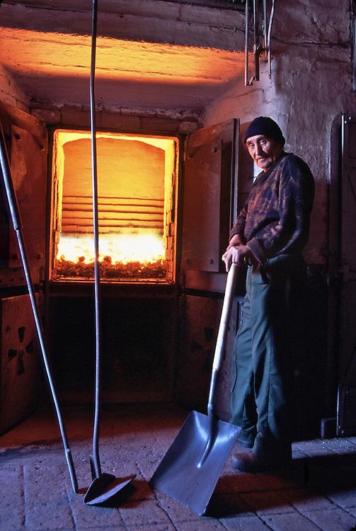 Tending the fire for drying the malt at Balvenie Distillery, Dufftown, Scotland.