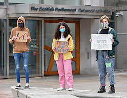 A small group of students rallied outside the Scottish Parliament to protest at the SQA exam body's re-grading of pupil qualifications which organisers say failed thousands of disadvantaged students across Scotland. <br /> <br /> © Dave Johnston / EEm