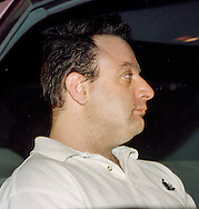 John Denofa, right, 35, of Buckingham, Pa., sits in a police vehicle, waiting to be transported to Bucks County Prison, after his arraignment, Friday, April 7, 2000, in Ottsville, Pa. Denofa is charged with the murder of Rachel Siani, the exotic dancer and college student. Siani's corpse was found April 1, in Burlington, NJ. (Photo by William Thomas Cain/Cain Images)