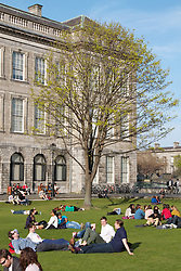 "Trinity College, Dublin formally known as the College of the Holy and Undivided Trinity of Queen Elizabeth near Dublin, was founded in 1592 by letters patent from Queen Elizabeth I as the ""mother of a university"". .Trinity College is now surrounded by Dublin and is located on College Green, opposite the former Irish Houses of Parliament. The college proper occupies 190,000 m2 (47 acres), with many of its buildings ranged around large quadrangles (known as 'squares') and two playing fields.It is the sole constituent college of the University of Dublin, unlike the universities of Oxford and of Cambridge after which it was modelled and both of which comprise many constituent colleges. .Thus the designations ""Trinity College, Dublin"" and ""University of Dublin"" are usually synonymous for practical purposes. Trinity College is one of the seven ancient universities of Britain and Ireland. It is Ireland's oldest university..Originally established outside the city walls of Dublin in the buildings of the dissolved Augustinian Priory of All Hallows, Trinity College was set up in part to consolidate the rule of the Tudor monarchy in Ireland, and it was seen as the university of the Protestant Ascendancy for much of its history; although Roman Catholics and Dissenters had been permitted to enter as early as 1793,certain restrictions on their membership of the college remained until 1873 (professorships, fellowships and scholarships were reserved for Protestants), and the Catholic Church in Ireland forbade its adherents, without permission from their bishop, from attending until 1970. Women were first admitted to the college as full members in 1904.."