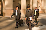 Businesmen walking in front of Toronto's Union Station on a sunny autumn afternoon.