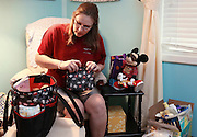 Melissa Kennedy packs up a variety of clothing items and other newborn baby necessities Thursday at her home in Vina for when she goes to the hospital to have her baby. She lives too great of a distance from the hospital where she will give birth to just stop back by her home and must prepare for everything beforehand.