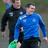 St Johnstone Training....13.12.13<br /> David Robertson pictured in training this morning alongside manager Tommy Wright after being told his contract won't be renewed<br /> Picture by Graeme Hart.<br /> Copyright Perthshire Picture Agency<br /> Tel: 01738 623350  Mobile: 07990 594431