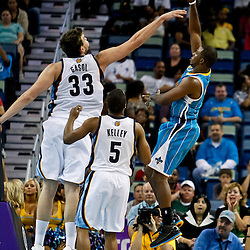 October 9, 2010; New Orleans, LA, USA; New Orleans Hornets point guard Chris Paul (3) shoots over Memphis Grizzlies center Marc Gasol (33) and guard Tre Kelly (5) during the second quarter of a preseason game at the New Orleans Arena. Mandatory Credit: Derick E. Hingle