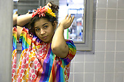 Astoria, New York<br /> March 30, 3016<br /> Kathy Vergara, 24, tries on her clown uniform during a training she is leading at Blue Balloon Parties in Astoria, Queens.  She says she has a drastically different personality when inside her costume.  Vergara is also currently pregnant with twins.<br /> 3/30/16<br /> Tatiana Flowers/ CUNY Graduate School of Journalism)
