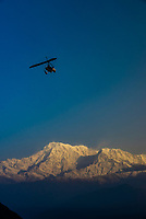 An ultralight on a sightseeing flight from Pokhara airport heads toward Annapurna 1, the 10th highest peak in the world (26,545 feet/8091 meters) in the Annapurna Massif of the HIimalayas, near Pokhara, Nepal.