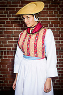 Rebekka, member of the 'Die Blankeneser Trachtengruppe 1984 &ndash; 2014 im Blankeneser M&auml;nner TurnVerein' is wearing an original traditional bridal costume in Blankenese, Hamburg, Germany on November 5, 2016.<br /> <br /> The bridal dress has been worn by young women from the low income class (Brauttracht der Unbemittelten).<br /> <br /> This is part of the series about Traditional Wedding Gowns from different regions of Germany, worn by young members of local dance groups and cultural associations that exist to preserve and celebrate the cultural heritage. The portraiture series is a depiction of an old era with different social values and religious beliefs in an antiquated civil society with very few of those dresses left.
