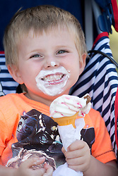 © Licensed to London News Pictures. 24/07/2013. Stratford upon Avon, Warwickshire, UK. As temperatures rise after the recent thunderstorms and rain, people flocked to Stratford upon Avon to start enjoying the sun. Pictured, two years old Tanner McNally enjoys an ice cream near the river. Photo credit : Dave Warren/LNP