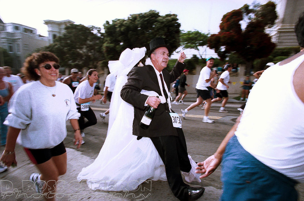 One of the many costumed runners in the 90th Bay to Breakers in San Francisco reaches the top of the Hayes Street Hill, Sunday, May 20, 2001. (Photo by D. Ross Cameron)