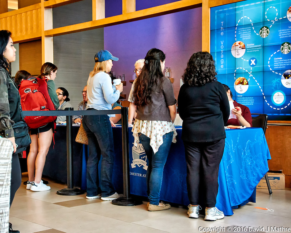 Students and life-long learners signing up for the Semester at Sea, 2016 Spring Semester Voyage at the Hilton hotel in San Diego. Image taken with a Nikon 1 V3 camera and 10-30 mm VR lens (ISO 800, 18 mm, f/4.5, 1/80 sec).