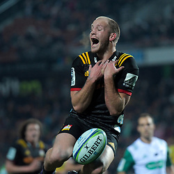 Marty McKenzie (Chiefs) goes up for a high ball during the Super Rugby match between the Chiefs and Hurricanes at FMG Stadium in Hamilton, New Zealand on Friday, 13 July 2018. Photo: Dave Lintott / lintottphoto.co.nz