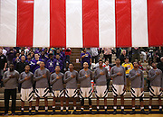 Merrillville players stand for the National Anthem before their game against Crown Point Friday at Merrillville.
