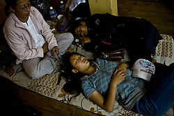 INDIA - Life in Exile (Tibetan Refugees) <br /> Tibetan refugees rest at Reception Center, a temporary shelter for newly arrived Tibetan refugees in McLeod Ganj, Dharamsala, India, where the Dalai Lama settled after fleeing Tibet in 1959 after a failed uprising against Chinese rule, June 3, 2009.