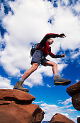Hiker jumps over gap in rocks, South Kaibab Trail, Grand Canyon National Park, Arizona..Subject photograph(s) are copyright Edward McCain. All rights are reserved except those specifically granted by Edward McCain in writing prior to publication...McCain Photography.211 S 4th Avenue.Tucson, AZ 85701-2103.(520) 623-1998.mobile: (520) 990-0999.fax: (520) 623-1190.http://www.mccainphoto.com.edward@mccainphoto.com..