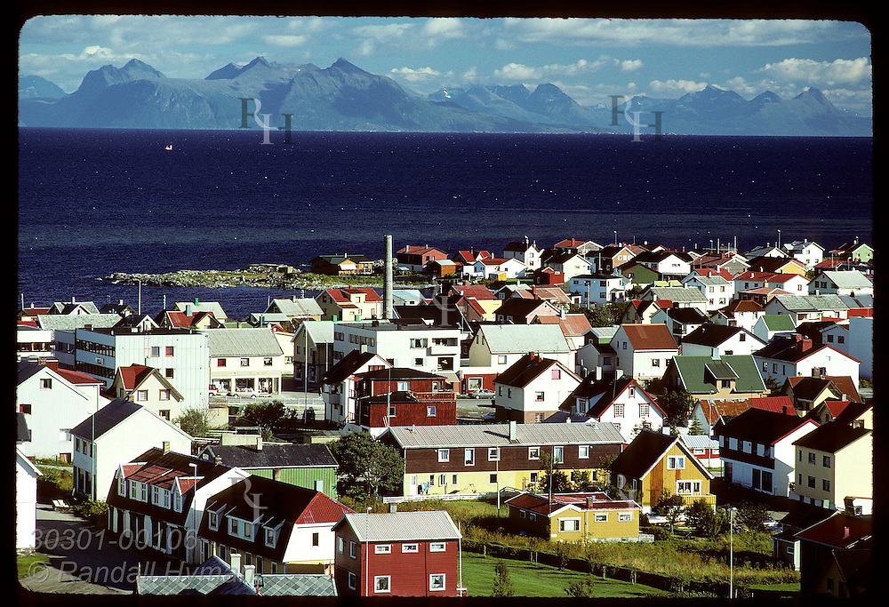 Arctic town of Andenes, as seen from lighthouse on August day, is air-base and whale-watch center. Norway