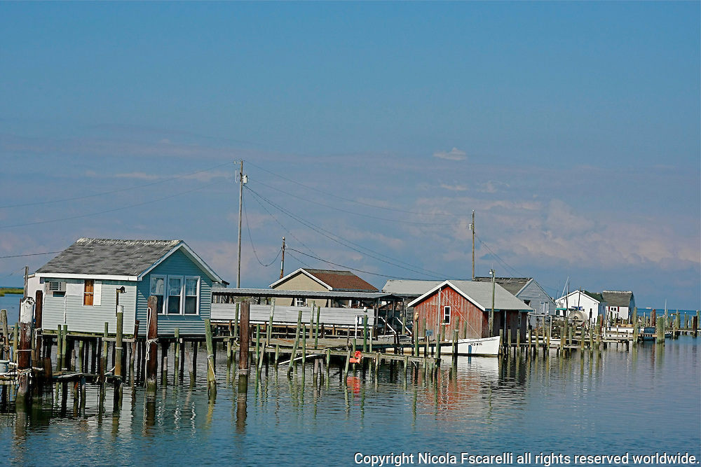 As we approached the main dock on Tangier Island, the dock side crab-huts seem to be floating on the water.
