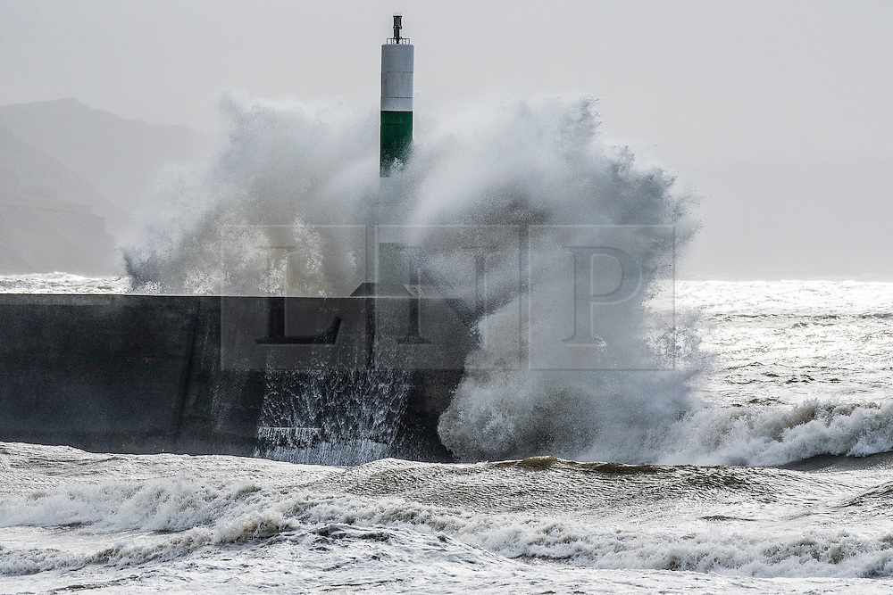 © London News Pictures. 05/03/2017. Aberystwyth, UK. On a day of increasingly strong winds, and with even more ferocious  gales forecast into the evening with the threat of snow on high ground,  mountainous high waves batter the promenade and sea defences in Aberystwyth  on the Cardigan Bay coast of West Wales. Photo credit: Keith Morris/LNP