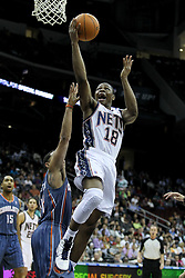 Apr 11; Newark, NJ, USA; New Jersey Nets guard Ben Uzoh (18) makes a layup during the first half of their game against the Charlotte Bobcats at the Prudential Center.
