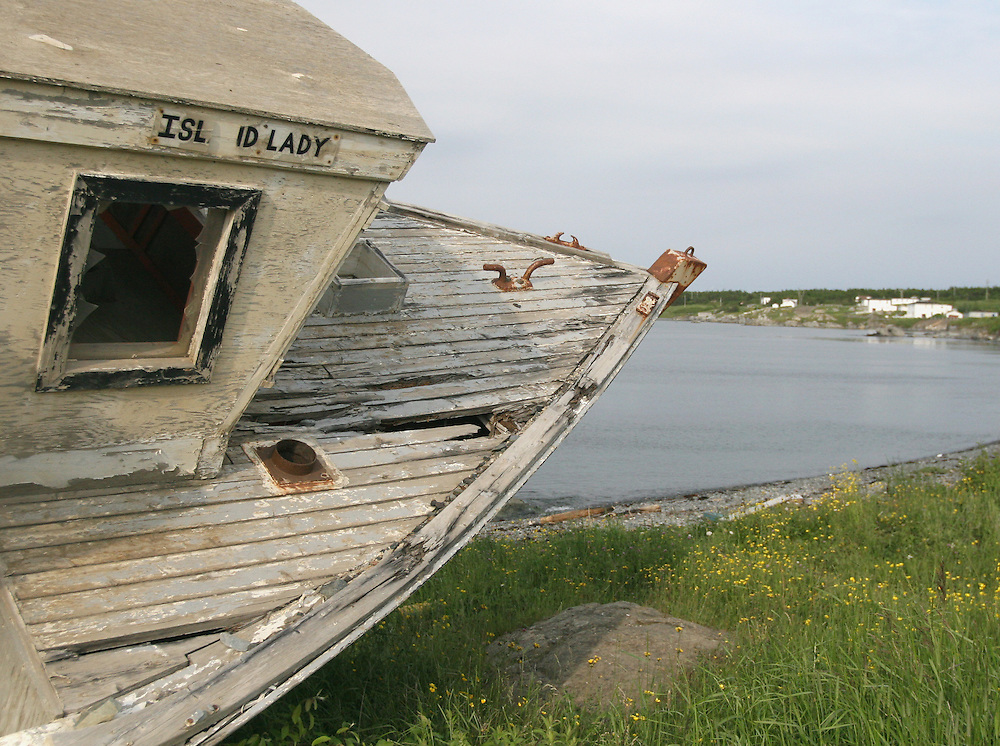 13 July 2007 Kittiwake Coast, NL, Canada,  --..The Island Lady dry rots on the shore in tiny St. Brendan's, NL.  The island's population has dwindled to 160 since cod fishing was banned in 1986.  The few that remain fish lobster and snow crabs in the limited seasons...Photo by Will Nunnally / Will Nunnally Photography