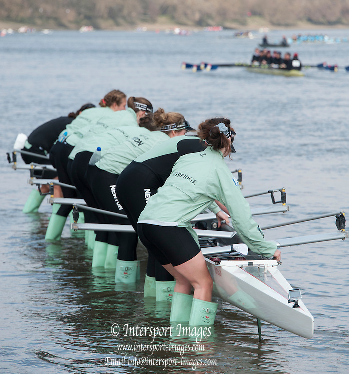 London, Great Britain. CUWBC after the race, lifting and carrying their boat back to the trailer.  General Views on Putney Hard. 2015 Women's Head of the River Race, Chiswick to Putney, Championship Course, River Thames.  England. <br /> Saturday  14/03/2015<br /> <br /> [Mandatory Credit; Intersport-images]