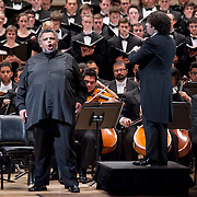 "December 12, 2012 - New York, NY : Conductor Gustavo Dudamel, on platform, leads the  Westminster Symphonic Choir and the Simón Bolívar Symphony Orchestra of Venezuela, along with tenor Idwer Álvarez, standing at center left, as they perform Antonio Estévez's ""Cantata criolla"" at Carnegie Hall's Stern Auditorium / Perelman Stage on Tuesday evening.  CREDIT: Karsten Moran for The New York Times"