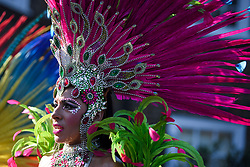 © Licensed to London News Pictures. 26/08/2019. London, UK.  Woman in carnival dress at day two of the Notting Hill carnival. The two day event is the second largest street festival in the world after the Rio Carnival in Brazil, attracting over 1 million people to the streets of West London. Photo credit: Ben Cawthra/LNP