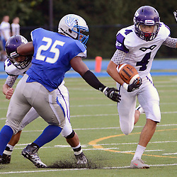 Photos by Tom Kelly IV<br /> Phoenixville's Mackensie Thomas (4) runs with the ball as Great Valley's Chris Temple (25) tries to grab him, during the Great Valley vs Phoenixville high school football game, Saturday night August 31, 2013 at Great Valley High School in East Whiteland.