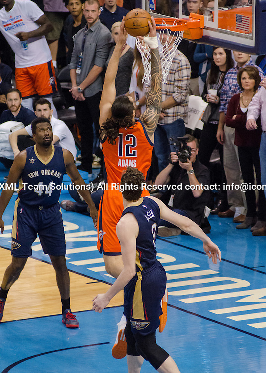 OKLAHOMA CITY, OK - DECEMBER 04:  Oklahoma City Thunder Center Steven Adams (12) dunking the ball versus New Orleans Pelicans  on December 04, 2016, at the Chesapeake Energy Arena Oklahoma City, OK. (Photo by Torrey Purvey/Icon Sportswire)