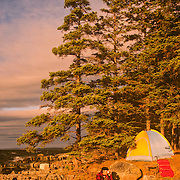 Camping on an island at sunset in Maine.