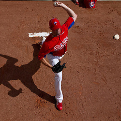 March 03, 2012; Clearwater, FL, USA; Philadelphia Phillies starting pitcher Cole Hamels (35) warms up in the bull pen during spring training game against the New York Yankees at Bright House Networks Field. Mandatory Credit: Derick E. Hingle-US PRESSWIRE