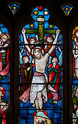 Victorian 19th century stained glass window, church of Bradfield Combust, Suffolk, England, UK - Crucifixion c 1869