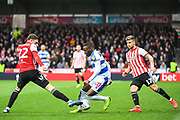 Brentford Defender Henrik Dalsgaard (22) takes the ball away from Queens Park Rangers Midfielder Bright Osayi-Samuel (20) during the EFL Sky Bet Championship match between Brentford and Queens Park Rangers at Griffin Park, London, England on 2 March 2019.