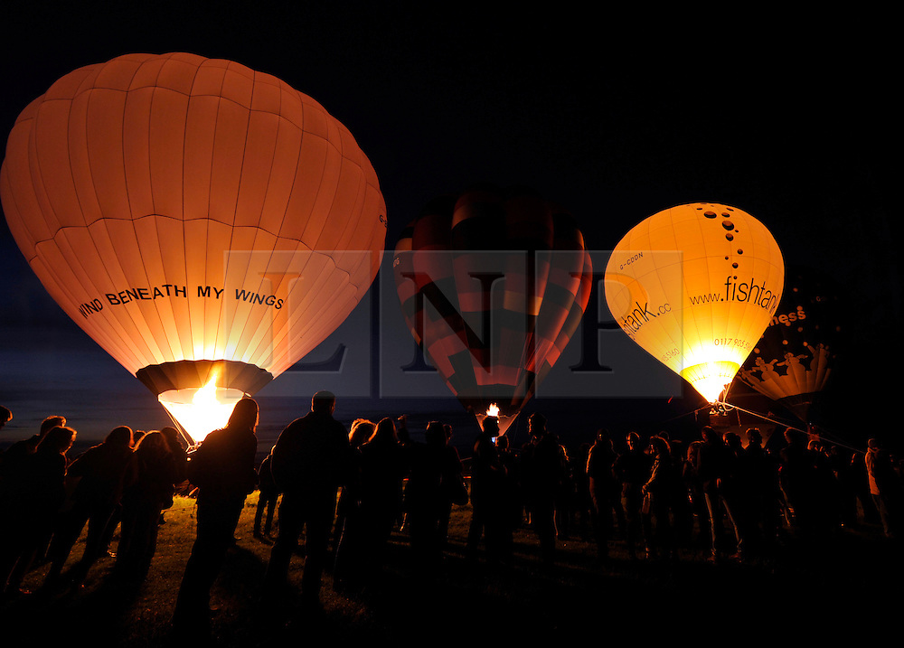 © Licensed to London News Pictures. 04/06/2012. Bath, UK. Balloon night glow on Solsbury Hill, above the city of Bath, as part of the Jubilee Beacons network. The Royal Jubilee celebrations. Great Britain is celebrating the 60th  anniversary of the countries Monarch HRH Queen Elizabeth II accession to the throne this weekend Photo credit : Simon Chapman/LNP