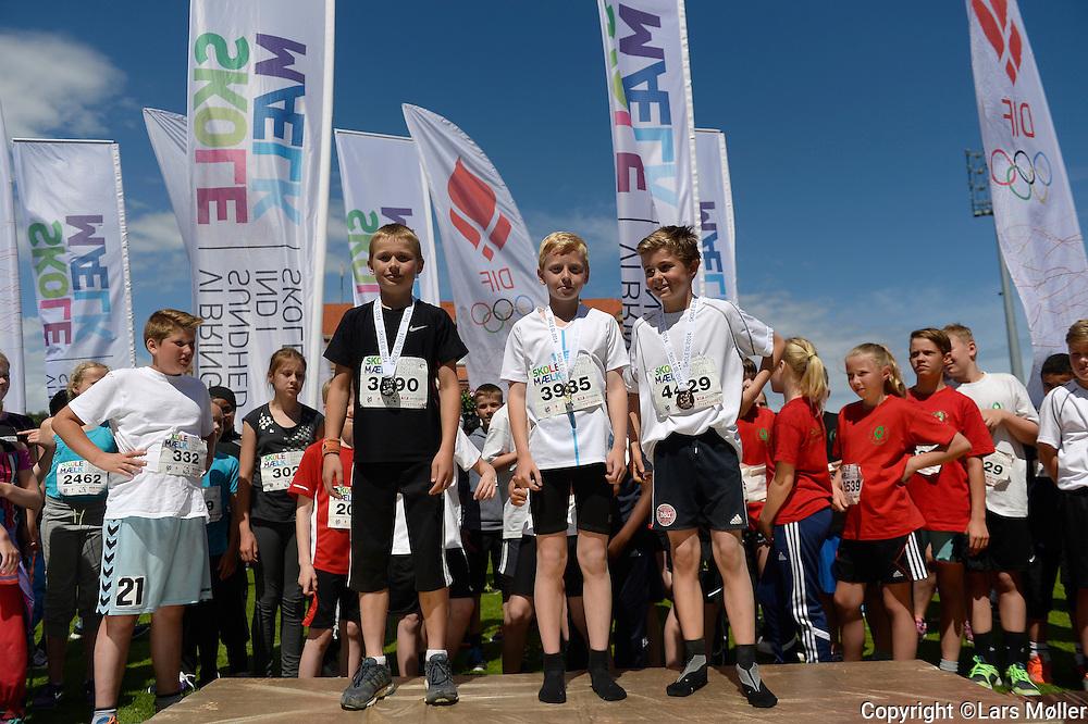 DK Caption:<br /> 20140617, K&oslash;benhavn, Danmark:<br /> Skole OL finale 2014: l&aelig;ngdespring medaljevindere drenge<br /> Foto: Lars M&oslash;ller<br /> UK Caption:<br /> 20140617, Copenhagen, Denmark:<br /> School Olympics 2014: long jump medal winners boys<br /> Photo: Lars Moeller